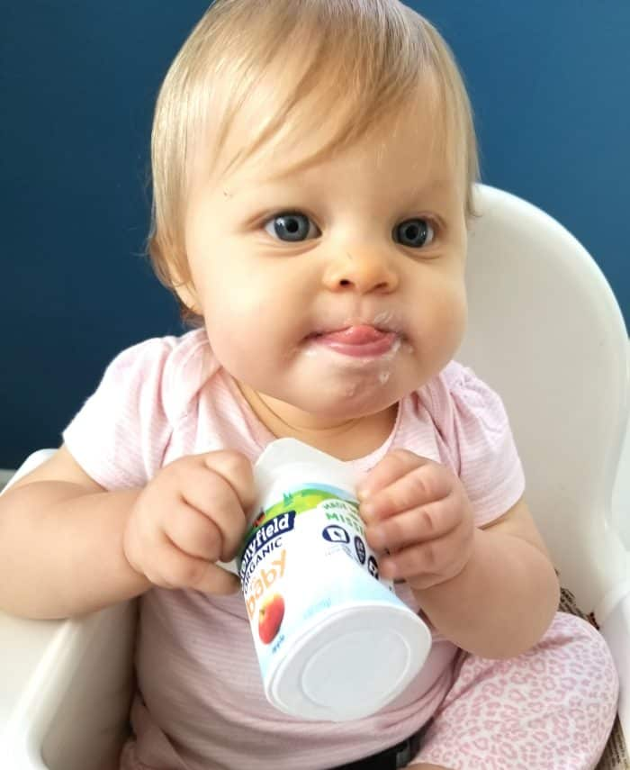My sick toddler enjoying some stonyfield baby yogurt